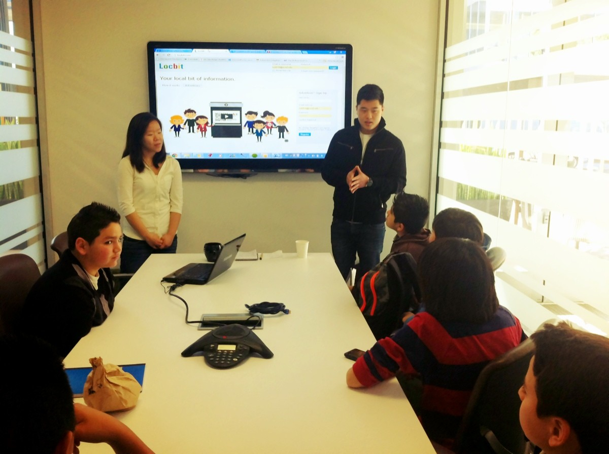 Locbit interns Esther Kim and Alex Chun describe to students how the startup CEO and founder is only 25 years old and is serving clients like the PGA Tour.