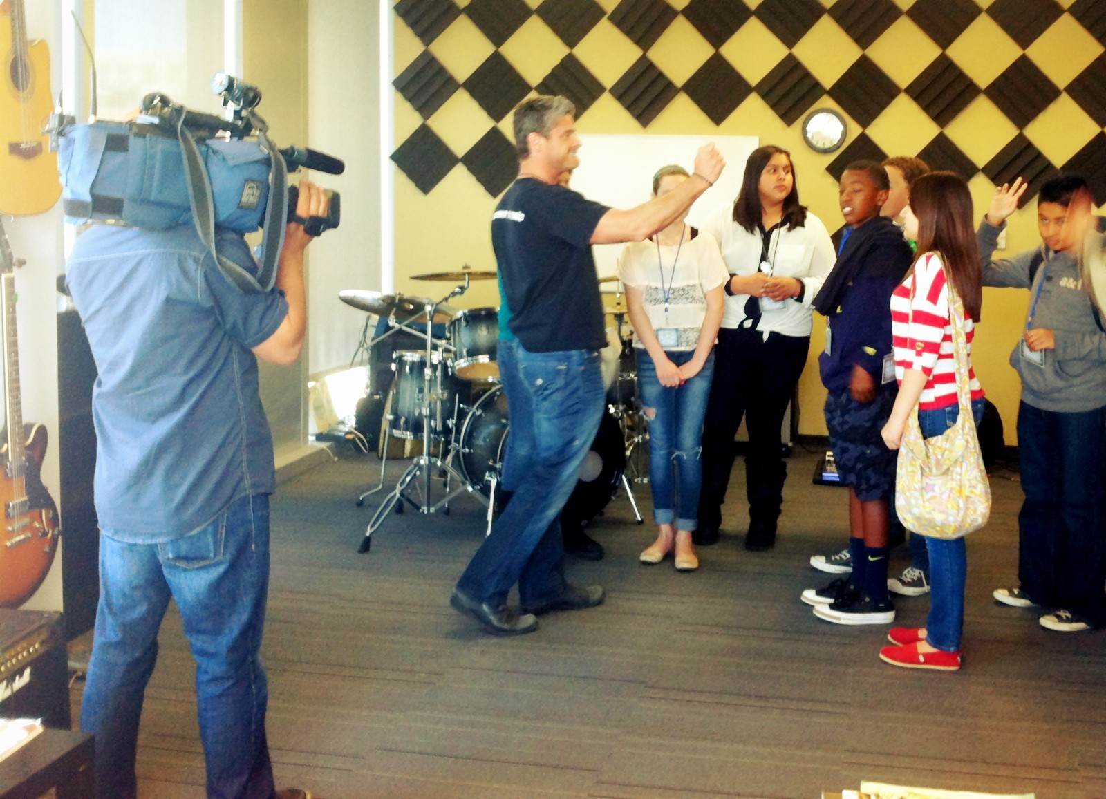 Steven Cox, Take Lessons Founder, filmed by local news with Startup Class students.